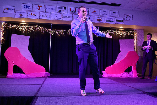 Contestant DJ Morgan speaks briefly during the introduction portion of the Women's Resource Center's Hunks in Heels event Friday night at the Beckley-Raleigh County Convention Center.
