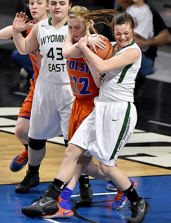 (Brad Davis/The Register-Herald) Wyoming East's Katie Daniels battles for a loose ball during the Lady Warriors' first round win over the Rebels in the state basketball tournament Wednesday evening at the Charleston Civic Center.