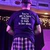 Contestant Jim Chambers shows off his shirt during the introduction portion of the Women's Resource Center's Hunks in Heels event Friday night at the Beckley-Raleigh County Convention Center.