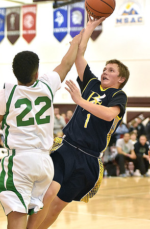 (Brad Davis/The Register-Herald) Blue Gold Select's Kyle Smith drives to the basket as Tazwell Bulldogs player Octavius Pridgen defends during Biddy Buddy action Saturday afternoon at Woodrow Wilson High School.