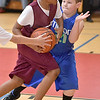 (Brad Davis/The Register-Herald) Beckley's Jonathan Moore drives to the basket as Milton's Josiah Noe defends during a 4th grade bracket game in the annual Biddy Buddy youth basketball tournament Friday afternoon at the YMCA of Southern West Virginia.