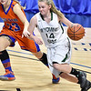 (Brad Davis/The Register-Herald) Wyoming East's Jasmine Blankenship drives to the basket as Tolsia's Alyssa Cloud defends during the Lady Warriors' first round win over the Rebels in the state basketball tournament Wednesday evening at the Charleston Civic Center.