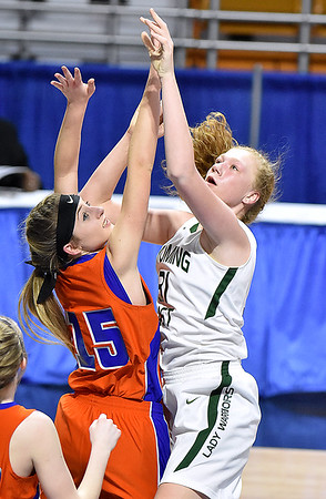 (Brad Davis/The Register-Herald) Wyoming East's Emily Saunders tries to score during the Lady Warriors' first round win over the Rebels in the state basketball tournament Wednesday evening at the Charleston Civic Center.