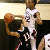 (Brad Davis/The Register-Herald) Oak Hill's Abraham Farrow has nowhere to go as he runs into tough defense from Woodrow Wilson's Ty Walton during the Flying Eagles' win over the Red Devils Wednesday night at the Beckley-Raleigh County Convention Center.