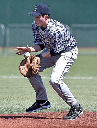 Shady Spring first baseman Grant Davis fields a ground ball during the Tigers' Upper Deck middle school baseball league game against the Eastern Greenbrier Rockies Saturday afternoon at Linda K. Epling Stadium.
