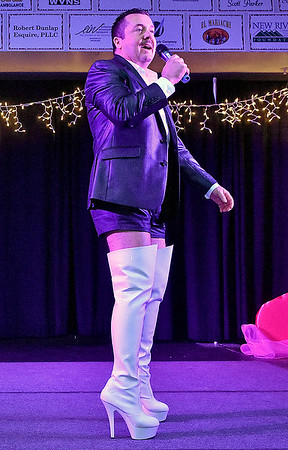 Contestant Scott Parker, the eventual Top Hunk winner, speaks briefly during the introduction portion of the Women's Resource Center's Hunks in Heels event Friday night at the Beckley-Raleigh County Convention Center.