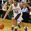(Brad Davis/The Register-Herald) Woodrow Wilson's Tarek Payne drives to the basket as Greenbrier East's Caleb Ward defends during the Flying Eagles' win against the Spartans Saturday evening at the Beckley-Raleigh County Convention Center.