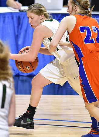 (Brad Davis/The Register-Herald) Wyoming East's Misa Quesenberry drives around Tolsia's Sarah Jude during the Lady Warriors' first round win over the Rebels in the state basketball tournament Wednesday evening at the Charleston Civic Center.