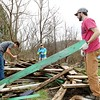 Jacob Kessinger, from left, 16, Tammy Stein, with the AmeriCorps Farm to Schools, and Active Southern West Virginia's Pedestrian, Bike and Trail Coordinator Andy Davis work to remove garden boxes from the Mt. Hope Community Garden in order to move it to a new location. (Chris Jackson/The Register-Herald)