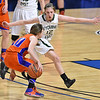 (Brad Davis/The Register-Herald) Wyoming East's Misa Quesenberry covers Tolsia's Dena Jarrells like a blanket during the Lady Warriors' first round win over the Rebels in the state basketball tournament Wednesday evening at the Charleston Civic Center.
