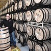 John Foster, director of sales Smooth Ambler Spirits on 745 Industrial Park Rd in Maxwelton, looks over barrel's bourbon in the company's Rick room. <br /> (Rick Barbero/The Register-Herald)