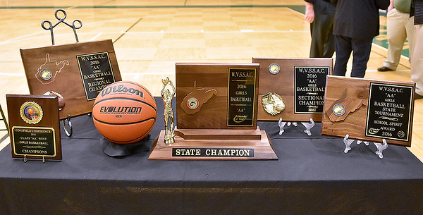 All the hardware collected during the Lady Warriors' postseason run, including the game ball from the title game, sit on display inside the gymnasium during a ceremony celebrating Wyoming East's first ever state championship Monday evening.