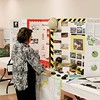 Judge Sherri Hunter looks over displays during the social studies fair at the Beckley-Raleigh County Convention Center in Beckley on Saturday. (Chris Jackson/The Register-Herald)