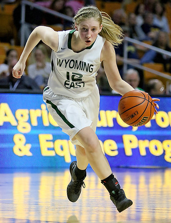 Wyoming East's Misa Quesenberry drives to the basket during the Lady Warriors' state tournament semifinal win over the Indians Friday afternoon at the Charleston Civic Center.