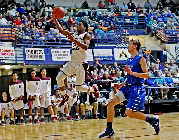 Isaiah Francis (22) scores the first of several quick fast breaks during the third quarter of their regional AAA basketball final against Ripley at the Beckley-Raleigh County Convention Center in Beckley on Tuesday. (Chris Jackson/The Register-Herald)