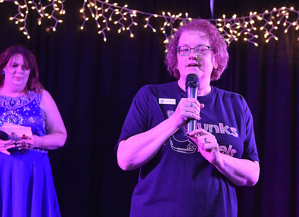 Dee Sizemore speaks during the opening moments of the Women's Resource Center's Hunks in Heels event Friday night at the Beckley-Raleigh County Convention Center.