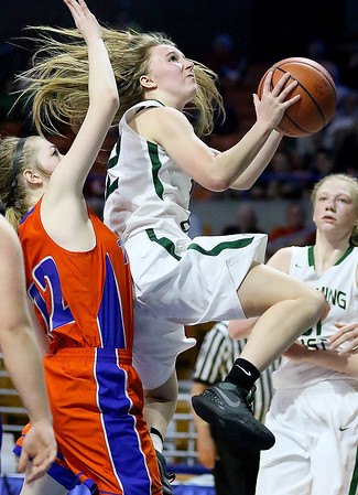 (Brad Davis/The Register-Herald) Wyoming East's Gabby Lupardus drives to the basket as Tolsia's Sarah Jude defends during the Lady Warriors' first round win over the Rebels in the state basketball tournament Wednesday evening at the Charleston Civic Center.