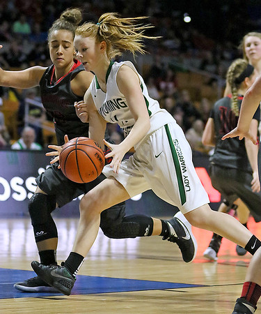 Wyoming East's Megan Davis drives to the basket as Sissonville's Marleigh Bays defends during the Lady Warriors' state tournament semifinal win over the Indians Friday afternoon at the Charleston Civic Center.