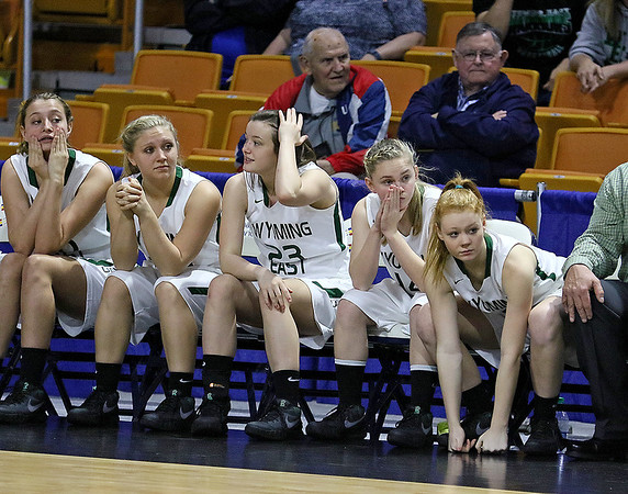 The Wyoming East bench watches events unfold on the court during the Lady Warriors' state tournament semifinal win over the Indians Friday afternoon at the Charleston Civic Center.