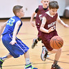(Brad Davis/The Register-Herald) Beckley's Mason Nettles dribbles his way around Milton's Cam Rivest as he moves the ball up the court during a 4th grade bracket game in the annual Biddy Buddy youth basketball tournament Friday afternoon at the YMCA of Southern West Virginia.