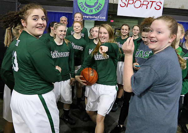 Wyoming East players notice the camera prior to taking the court to warm up for their class AA semifinal rematch against Sissonville Friday afternoon at the Charleston Civic Center.