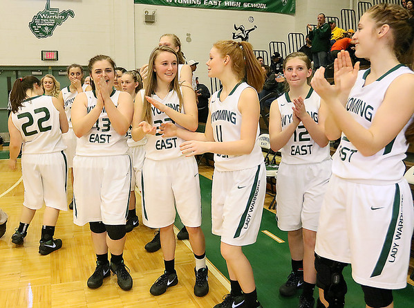 (Brad Davis/The Register-Herald) The Lady Warriors are all smiles leaving their bench as time runs out in the regional final against PikeView Friday night in New Richmond, sending them to Charleston for a second straight year.
