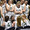 (Brad Davis/The Register-Herald) Wyoming East head coach Angie Boninsegna coaches up her team during a timeout in the Lady Warriors' first round win over the Tolsia Rebels in the state basketball tournament Wednesday evening at the Charleston Civic Center.