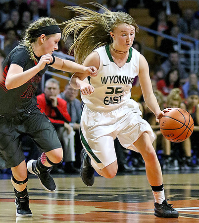 Wyoming East's Gabby Lupardus drives as Sissonville's Karli Pinkerton defends during the Lady Warriors' state tournament semifinal win over the Indians Friday afternoon at the Charleston Civic Center.