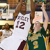 (Brad Davis/The Register-Herald) Woodrow Wilson's Ty Walton drives and scores as Greenbrier East's Seth Brown defends during the Flying Eagles' win against the Spartans Saturday evening at the Beckley-Raleigh County Convention Center.