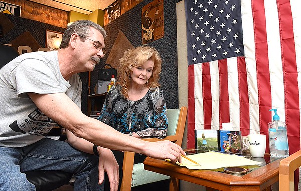 Nancy Miller, of Hollywood in Monroe County, right, works with Ernie Keller, owner EG3 Recording Studio located in Beckley, preparing to chart and lay tracts for some new music they will be recording.<br /> (Rick Barbero/The Register-Herald)