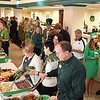 Large crowd gathered for the Business After Hours event held at United Bank on Main Street in Beckley Thursday afternoon.<br /> (Rick Barbero/The Register-Herald)