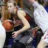 (Brad Davis/The Register-Herald) Summers County's Whittney Justice looks for a way to the basket as Sissonville's Karli Pinkerton defends during the Lady Bobcats' first round state tournamnet game against the Indians Wednedsay night at the Charleston Civic Center.