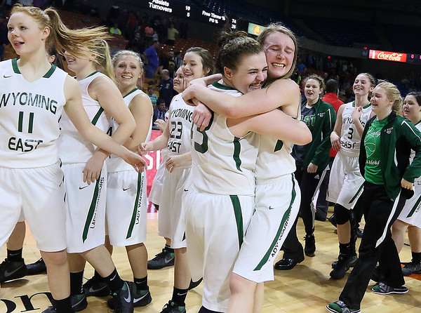 Wyoming East teammates Allie Lusk, left, and Gabby Lupardus hug each other in celebration after the Lady Warriors defeated the Sissonville Indians Friday afternoon to advance to the class AA state championship game at the Charleston Civic Center.
