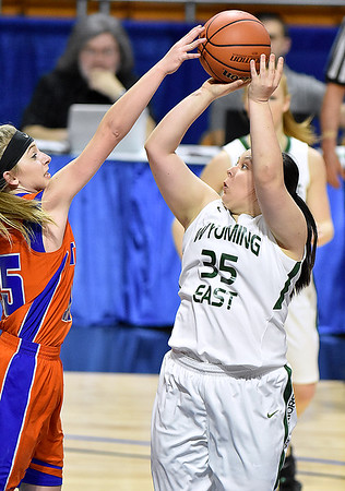 (Brad Davis/The Register-Herald) Wyoming East's Haley Butcher pulls up for a short jumper as Tolsia's Tasha Nichols defends during the Lady Warriors' first round win over the Rebels in the state basketball tournament Wednesday evening at the Charleston Civic Center.