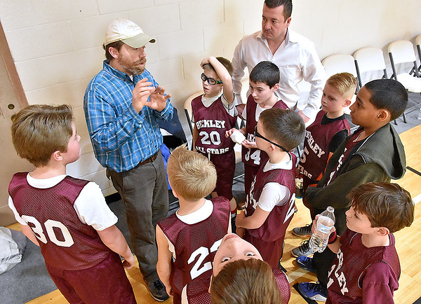 (Brad Davis/The Register-Herald) Head coach Ryan Snuffer, left, encourages his young Beckley All Stars team during a quick meeting following their 4th grade bracket game in the annual Biddy Buddy youth basketball tournament Friday afternoon at the YMCA of Southern West Virginia. Beckley, comprised of some of the best 4th grade basketball players around the area but with only three practices together, fell to a much more experienced Milton team 32-8, a squad full of kids who play regular travel ball. Snuffer congratulated his players for their effort throughout the game and encouraged them to keep their heads up, as they will hit the court again today for another game. Assistant coach Scott Parker looks on at right.