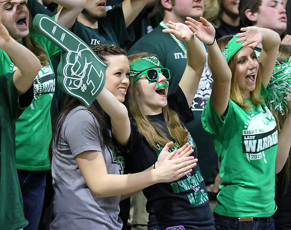 Wyoming East's students try to distract Sissonville players as they shoot free throws during the Lady Warriors' state tournament semifinal win over the Indians Friday afternoon at the Charleston Civic Center.