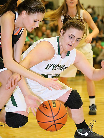 (Brad Davis/The Register-Herald) Wyoming East's Allie Lusk scrambles for a loose ball with PikeView's Madison May during the Lady Warriors' regional championship victory over the Panthers Friday night in New Richmond.
