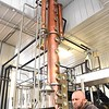 Paul Jackson with Smooth Ambler Spirits on 745 Industrial Park Rd in Maxwelton, looking over production information in front of the continus column still. <br /> (Rick Barbero/The Register-Herald)