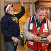 "Red Cross volunteers Garry Toler, right, and Robert Dunlap install smoke detectors inside a home on ""F"" Street in Beckley Saturday morning. The two, along with several other volunteer teams spent the day installing detectors for free around the Beckley area for those who'd scheduled appointments."