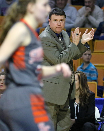 (Brad Davis/The Register-Herald) Summers County head coach Wayne Ryan rencourages his team during the Lady Bobcats' first round state tournamnet game against the Sissonville Indians Wednedsay night at the Charleston Civic Center.