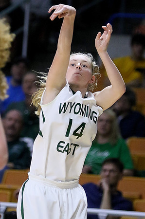 (Brad Davis/The Register-Herald) Wyoming East's Jasmine Blankenship hits from three-point range during the Lady Warriors' first round win over the Tolsia Rebels in the state basketball tournament Wednesday evening at the Charleston Civic Center.