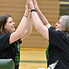 (Brad Davis/The Register-Herald) Wyoming East head coach Angie Boninsegna, right, high fives player Katlen Francis after she sang the national anthem during the opening moments of a ceremony celebrating the Lady Warriors' first ever girls basketball state championship Monday evening in the school's gymnasium.
