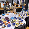 Area residents Lori Smith, left, and her mother Liz Fisher sort through an endless array of handmade bowls in search of the perfect one, or two, or five during Beckley Quota Club's Empty Bowls fundraiser Saturday morning inside The Place at United Methodist Temple.