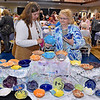 Area residents Becky Poland, left, and her mother Judy Crook sort through an endless array of handmade bowls in search of the perfect one, or two, or five during Beckley Quota Club's Empty Bowls fundraiser Saturday morning inside The Place at United Methodist Temple.