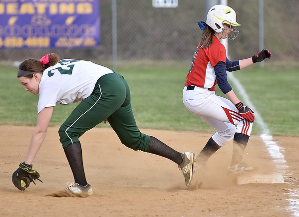(Brad Davis/The Register-Herald) Independence's Nicole Kester scrambles back to first base as Wyoming East's Rivers Wade has to reach out to snag a wide pickoff throw from catcher Chelsey Adkins during the Patriots' win over the Warriors in the first game of a doubleheader Wednesday evening in Coal City.