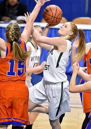 (Brad Davis/The Register-Herald) Wyoming East's Megan Davis drives to the basket as Tolsia's Tasha Nichols defends during the Lady Warriors' first round win over the Rebels in the state basketball tournament Wednesday evening at the Charleston Civic Center.