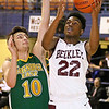 (Brad Davis/The Register-Herald) Woodrow Wilson's Isaiah Francis drives to the basket as Greenbrier East's Caleb Ward defends during the Flying Eagles' win against the Spartans Saturday evening at the Beckley-Raleigh County Convention Center.