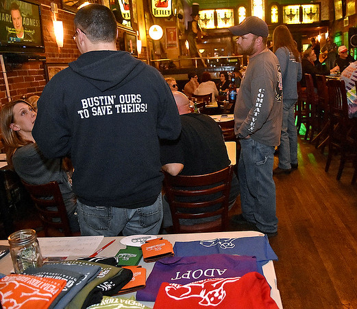 Members and supporters gathered during Operation Underdog's annual Wagfest fundraising event Saturday night at Foster's Main Street Tavern to raise money for general costs and a new van needed to continue transportation efforts within a network volunteers across the country.