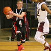 (Brad Davis/The Register-Herald) Oak Hill's Matt Honaker looks for an open teammate as he's pressured by Woodrow Wilson's Ty Walton during the Flying Eagles' win over the Red Devils Wednesday night at the Beckley-Raleigh County Convention Center.