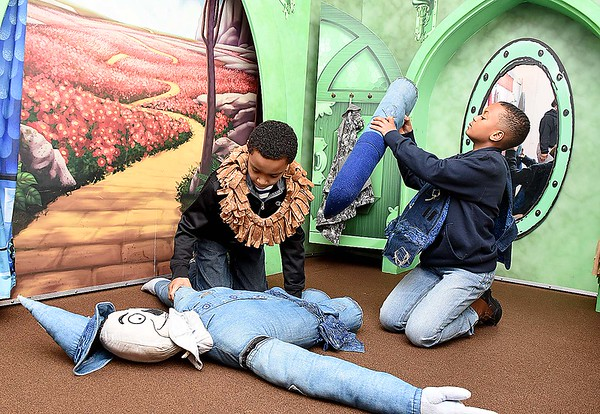 Cavon Tyler, left, and Trenton Tiggle, 5th graders in Melissa Brotsky's class at Edgewood Elementary School, put together the scarecrow in the Wizard of Oz exhibit at the Youth Museum in Beckley Monday morning.